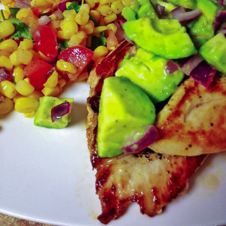 This Avocado Chicken recipe is a mouthful of fresh, delicious flavors with avocado, red onion, lime juice and spices that your whole family will love with a side of corn salsa!