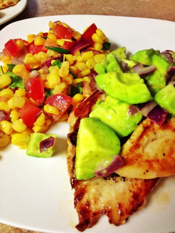 Looking for avocado chicken recipes? Here is a great one to try! This Avocado Chicken recipe is a mouthful of fresh, delicious flavors with avocado, red onion, lime juice and spices that your whole family will love with a side of corn salsa!