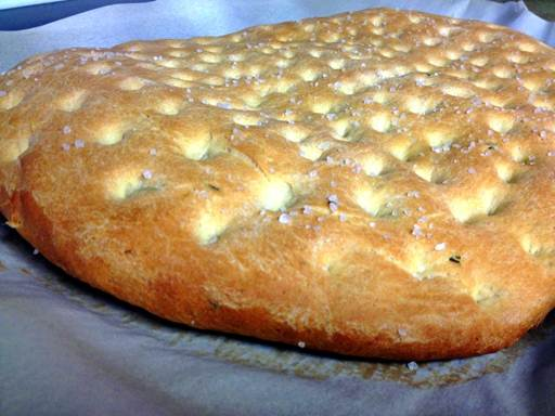 This Classic Rosemary Focaccia Bread recipe is easy to make and delicious with fresh rosemary, olive oil and course sea salt.