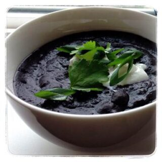 This Creamy Black Bean Soup recipe is a delectable combination of black beans, grated carrot, chicken broth, sour cream and spices for a soup that is delicious and high in protein and fiber!