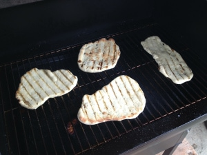 This Grilled Flatbread recipe is a fun and delicious way to make pizza on your grill and customize the toppings to your liking.