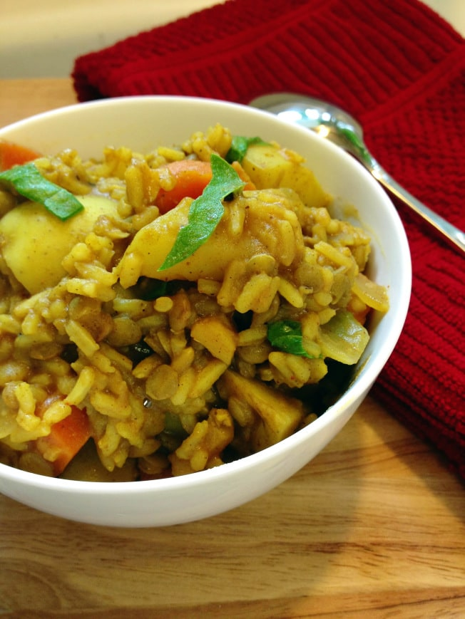 Lentils, rice, veggies and LOTS of herbs and spices make this One Pot Lentil Dahl and Rice recipe a dinnertime champion!