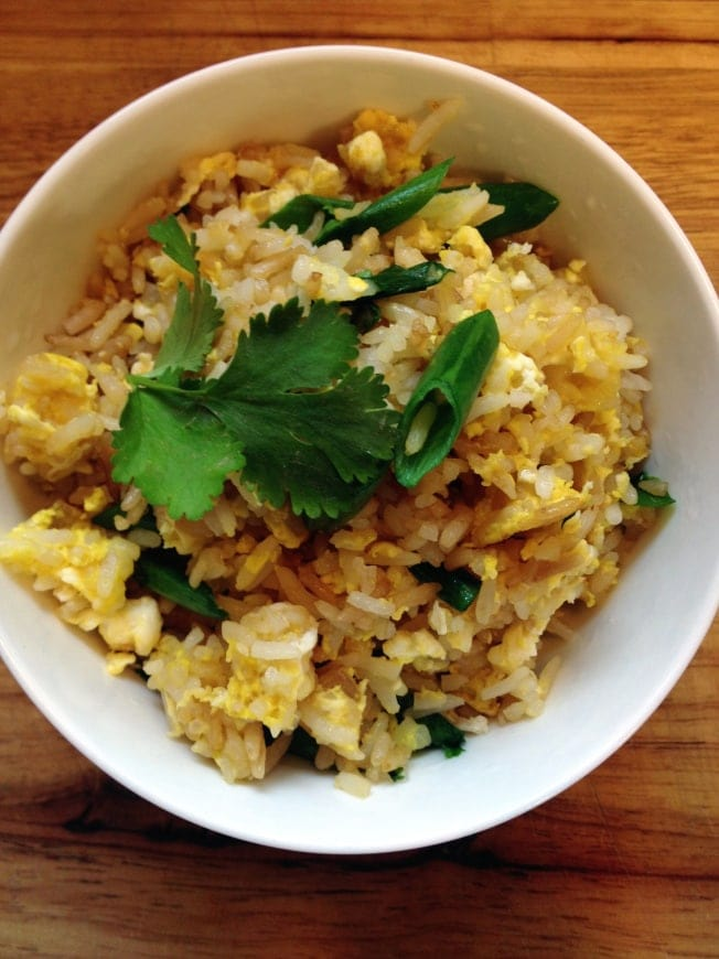 This easy Thai Fried Rice recipe is one of my favorite go-to meals on a busy weeknight. Do you want to learn how to make Thai fried rice?  Use leftover rice and your favorite protein and veggie additions to make Thai rice like you like it.
