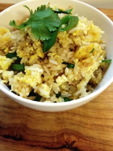 This easy Thai Fried Rice recipe is one of my favorite go-to meals on a busy weeknight. Use leftover rice and your favorite protein and veggie additions to make Thai rice like you like it.  Enjoy this Thai style rice recipe!