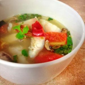 This Thai Hot and Sour Fish Soup recipe is heavenly with mushrooms, tomatoes, onions and spices and comes together in 20 minutes for a delicious meal!