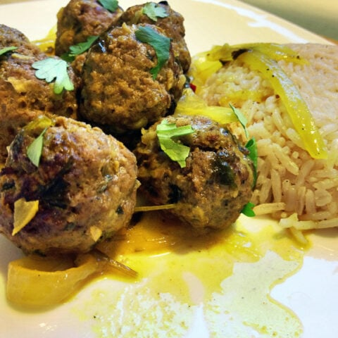 This Moroccan Kefta recipe combines ground beef with Moroccan spices and other seasonings for a delicious, flavorful Moroccan meatballs appetizer or main dish served with rice, salad or couscous.