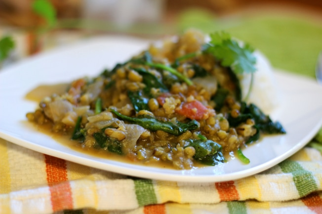 This Mung Bean Curry recipe is a healthy mix of mung beans, onion, tomato, spinach, ginger, garlic, green curry paste, coconut milk and spices that will delight your taste buds!
