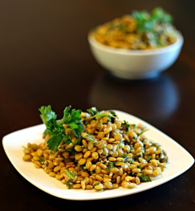 Looking for Lebanese side dishes?  Here is a great recipe! This Lebanese Warm Lentils recipe makes a great lentil side dish with a delicious combination of brown lentils, garlic, parsley, mint, arugula, lemon juice and spices.
