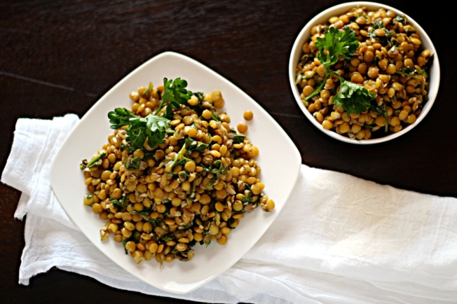 Looking for lentil side dish recipes?  Here is a great one! This Lebanese Warm Lentils recipe makes a great lentil side dish with a delicious combination of brown lentils, garlic, parsley, mint, arugula, lemon juice and spices.