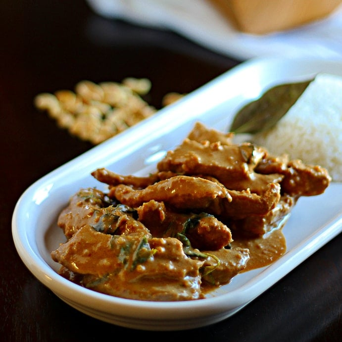 This Peanut Panang Curry recipe is rich, creamy and spicy with panang curry sauce, coconut milk, ground peanuts and lime leaves for a delicious meal!