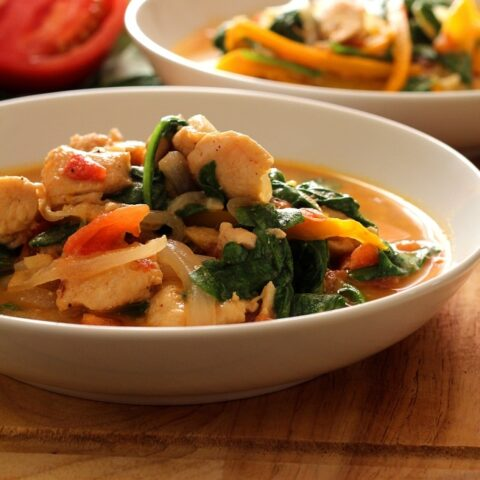 This delicious, Skinny Chicken Peanut Stew recipe is a tasty mix of chicken, onion, orange bell pepper, tomatoes, spinach, brown sugar, garlic, chili powder, powdered peanut butter and chicken broth for a low fat, low calorie dish!