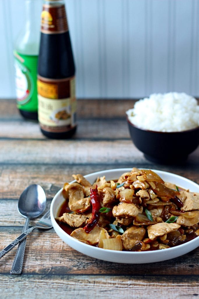 This Thai Chicken recipe is an easy stir-fry recipe that is so flavorful! This cashew chicken stir-fry combines chicken, yellow onion, green onion, dried red chilies, garlic, and toasted cashews for a delicious meal that is ready in 20 minutes.