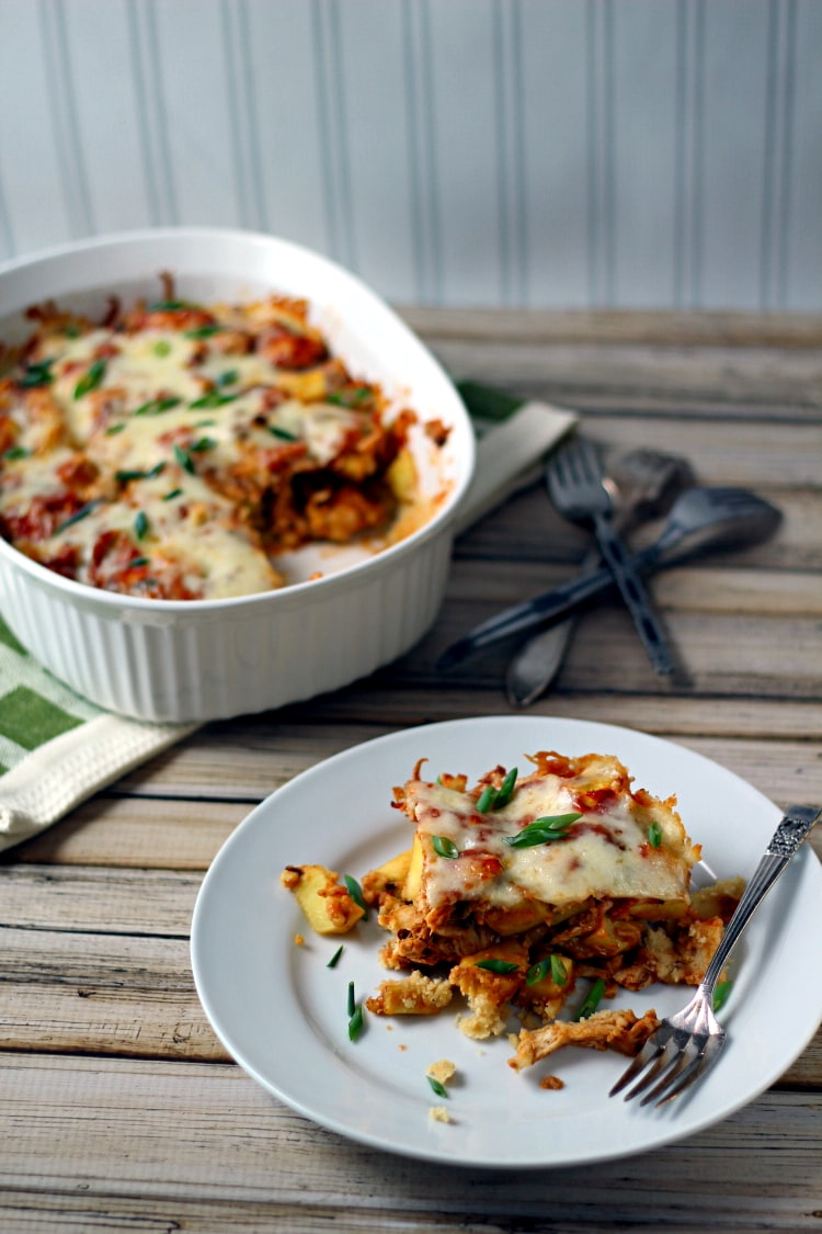 This easy Chicken Tamale Pie recipe has a masa corn base, filled with chicken, chipotle peppers and sweet potatoes with a cheesy topping for a fiesta of taste!