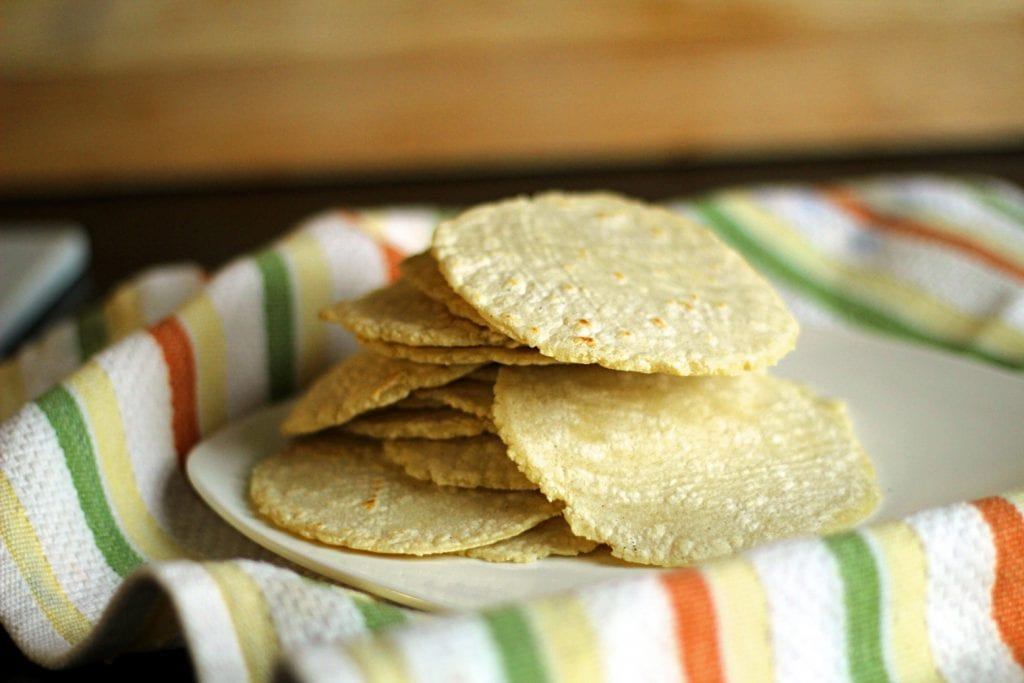 Looking for corn tortilla recipes? Here is a great one! Easy Homemade Corn Tortillas Recipe. These homemade corn tortillas are so, so, so easy to make and the result is soft, warm, and full of incredible flavor! You just measure, stir, form a ball, cover it, let it rest for 30 minutes, press into tortillas, and fry.