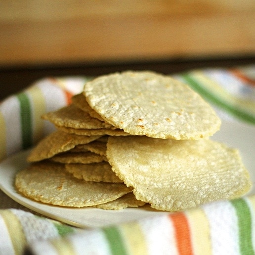 These homemade corn tortillas are so, so, so easy to make and the result is soft, warm, and full of incredible flavor! You just measure, stir, form a ball, cover it, let it rest for 30 minutes, press into tortillas, and fry.