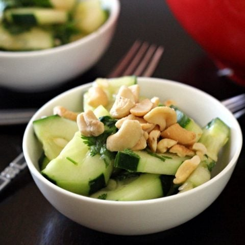 This Thai cucumber salad recipe mixes cucumbers, cashews, with a brown sugar, chili-garlic sauce, cilantro and lime juice for a delicious salad to add to your next Thai dinner.