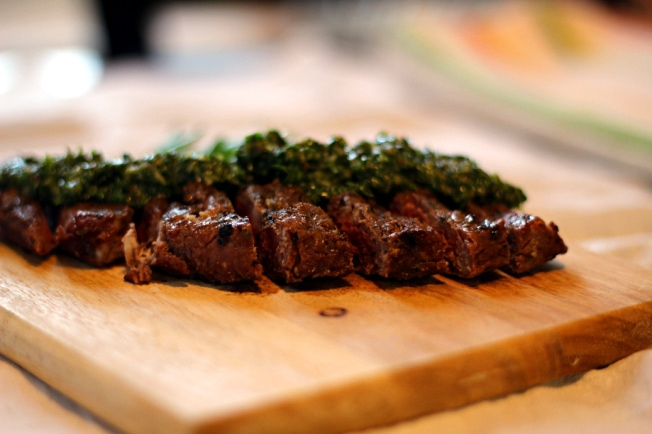 This Argentinian Espresso Rub Steak recipe features a delicious espresso and spice rub and fresh, homemade chimichurri sauce for a tasty meal.