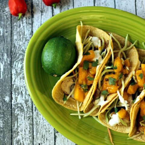 This Skinny Baja Fish Tacos recipe is a delicious low calorie fish tacos recipe with mango salsa, seasoned white fish, broccoli slaw and Greek yogurt.