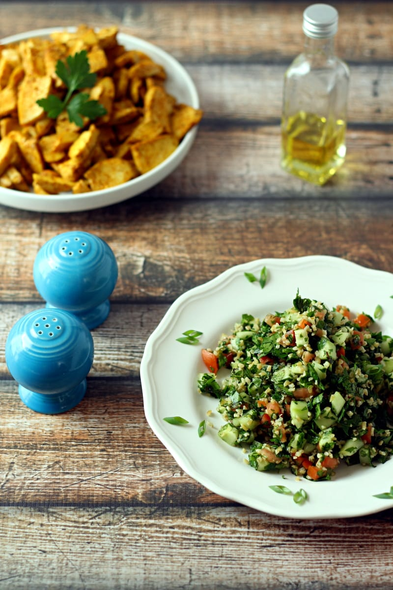 Looking for tabbouleh recipes?  Here is a great one! This delicious Tabbouleh Salad Recipe is a fresh herb and bulgur salad, with parsley, mint, diced cucumber and tomato, green onion with a simple olive oil and lemon juice dressing.