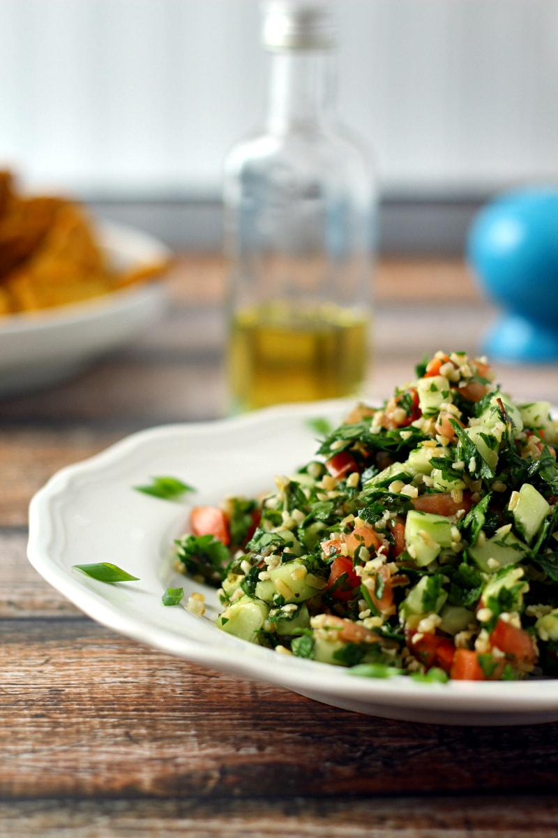 This delicious Tabbouleh Salad Recipe is a fresh herb and bulgur salad, with parsley, mint, diced cucumber and tomato, green onion with a simple olive oil and lemon juice dressing.