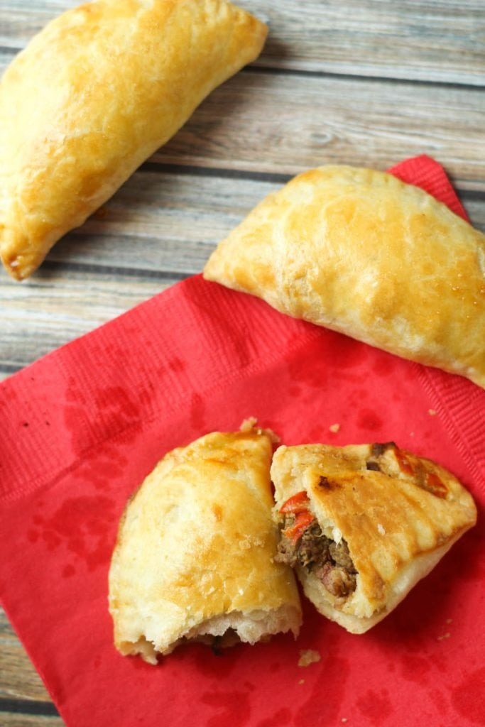 This Beef Empanadas recipe is delicious with buttery, flaky crust that blends with the spiced beef and bean filling for an appetizer that won't last long.