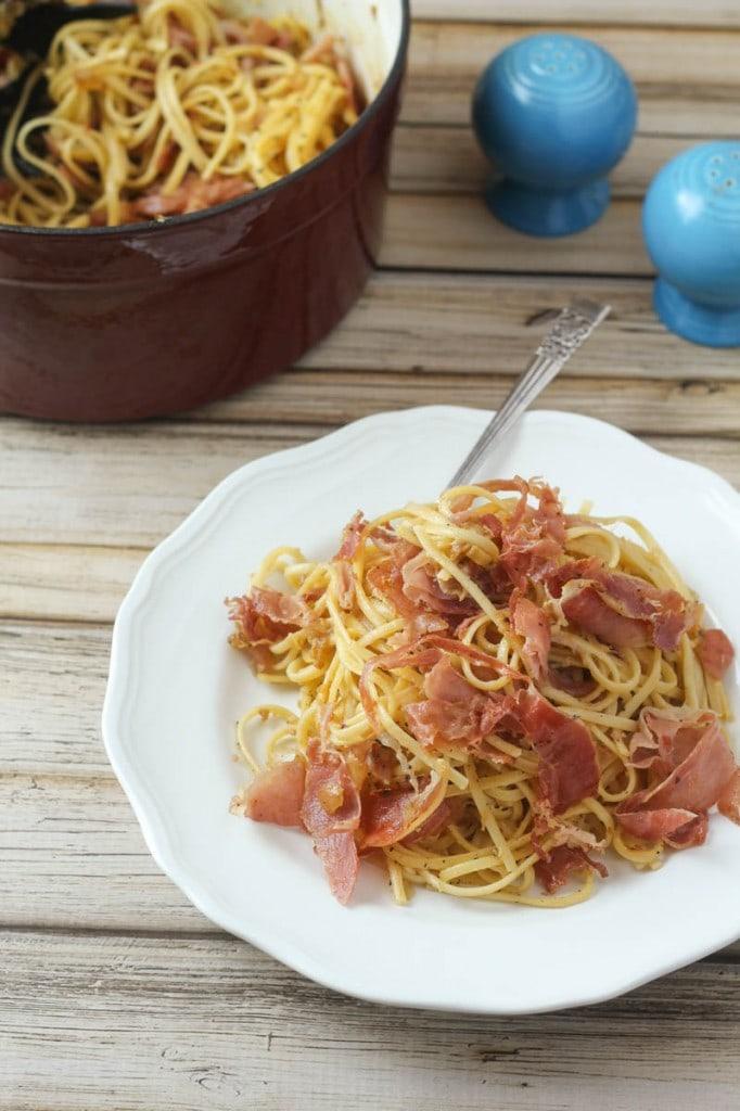 One of the best pasta recipes ever! Linguine Squarcierella: this delicious linguine pasta recipe combines linguine, prosciutto, onion, garlic, eggs, black pepper and Parmesan cheese to make the best pasta ever!