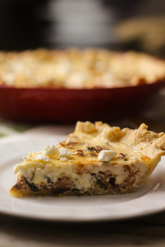 This delicious Mediterranean Quiche recipe mixes eggs, cream cheese, onions, tomatoes, roasted red peppers, kalamata olives, feta cheese and spices for a flavorful dish!