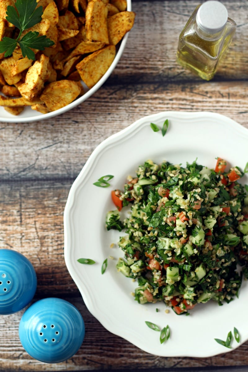 Looking for the best tabbouleh recipe?  Here you go! This delicious Tabbouleh Salad Recipe is a fresh herb and bulgur salad, with parsley, mint, diced cucumber and tomato, green onion with a simple olive oil and lemon juice dressing.