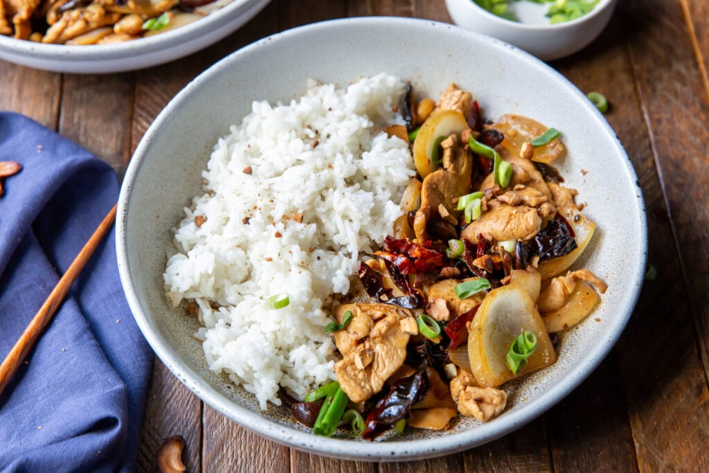 This Thai Chicken Cashew recipe is an easy stir-fry recipe that is so flavorful! This cashew chicken stir-fry combines chicken, yellow onion, green onion, dried red chilies, garlic, and toasted cashews for a delicious meal that is ready in 20 minutes.