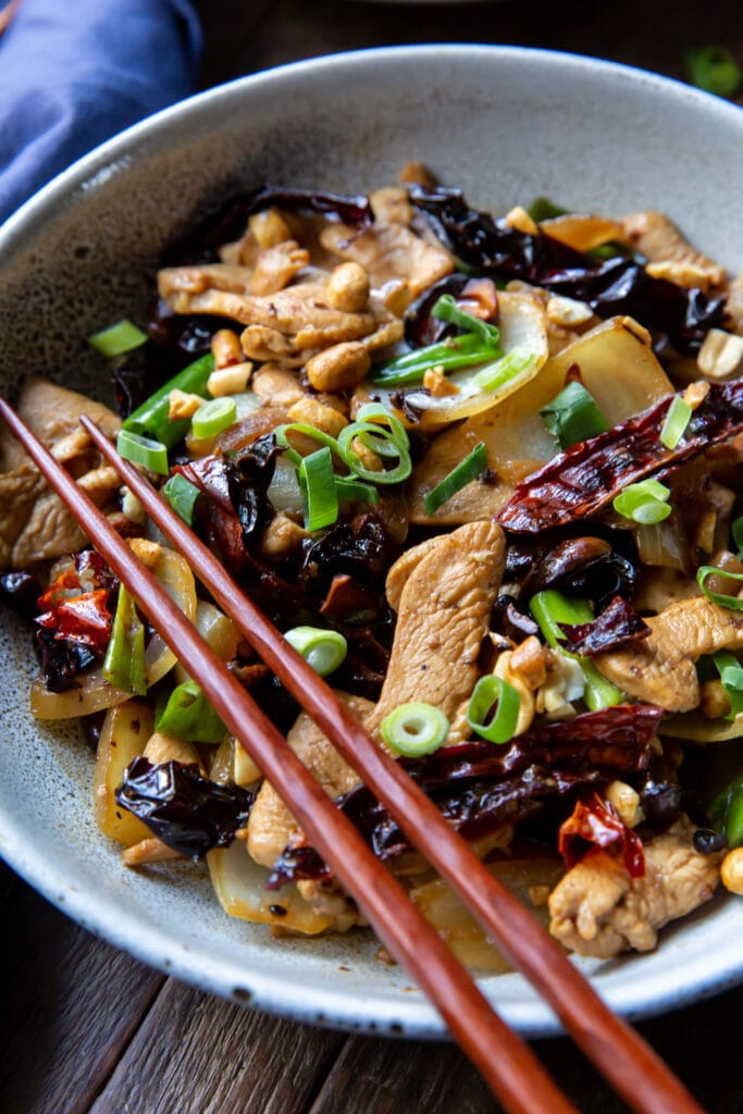 This Thai chicken cashew stir fry recipe is an easy recipe that is so flavorful! This cashew chicken stir-fry combines chicken, yellow onion, green onion, dried red chilies, garlic, and toasted cashews for a delicious meal that is ready in 20 minutes.
