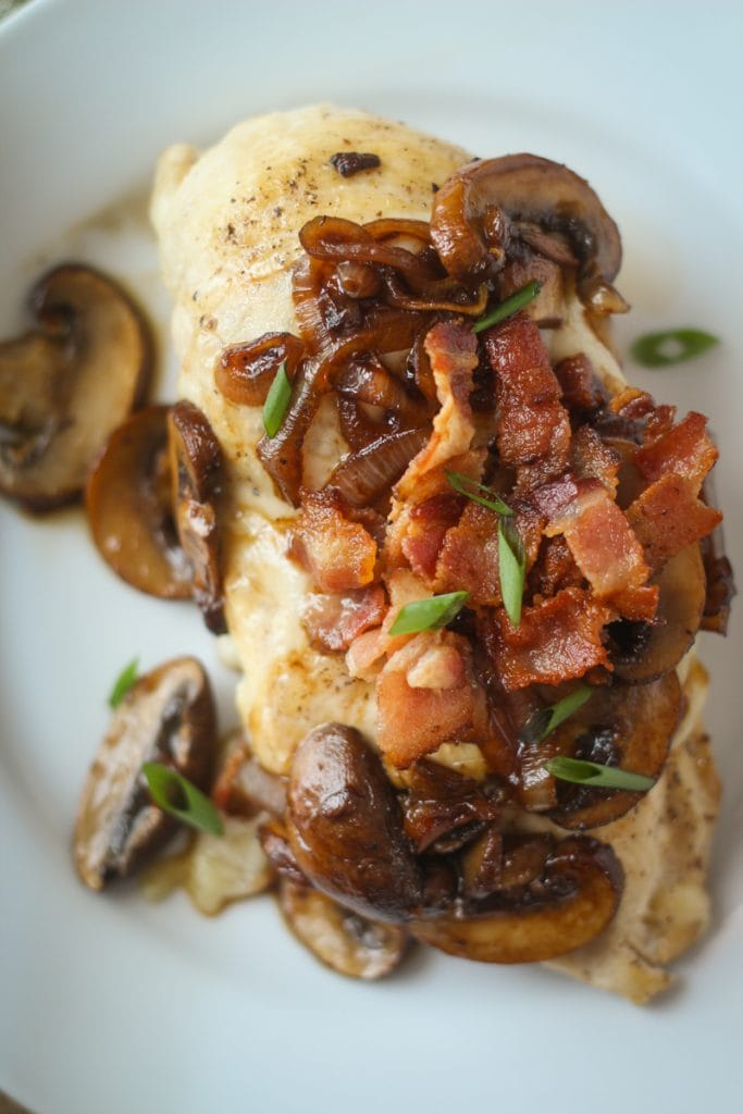 This Mushroom Swiss Chicken recipe is a delicious combination of chicken, Swiss cheese, brown mushrooms, bacon and yellow onion that tastes so good, I call it Chicken and Swiss Extraordinaire!