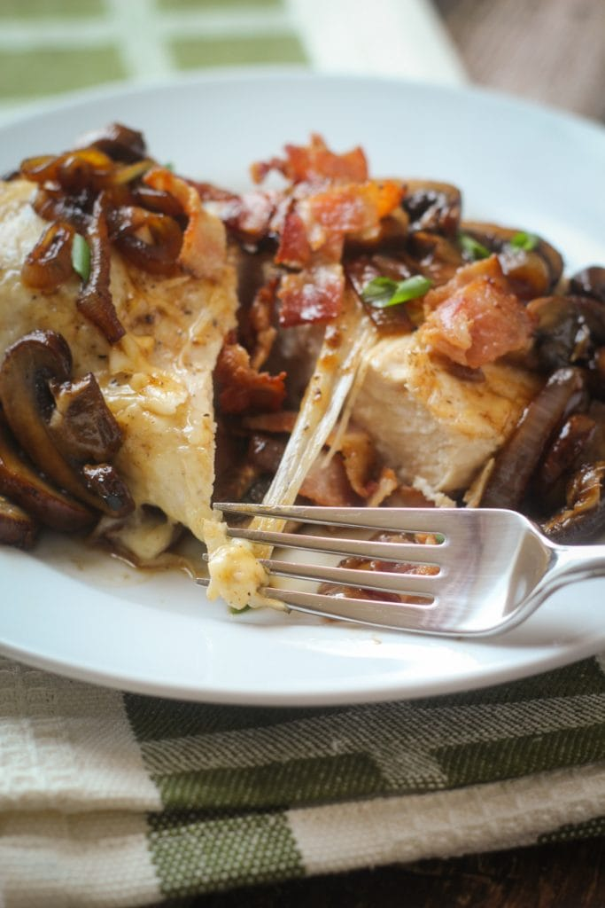 This Chicken Mushroom Swiss recipe is a delicious combination of chicken, Swiss cheese, brown mushrooms, bacon and yellow onion that tastes so good, I call it Chicken and Swiss Extraordinaire!