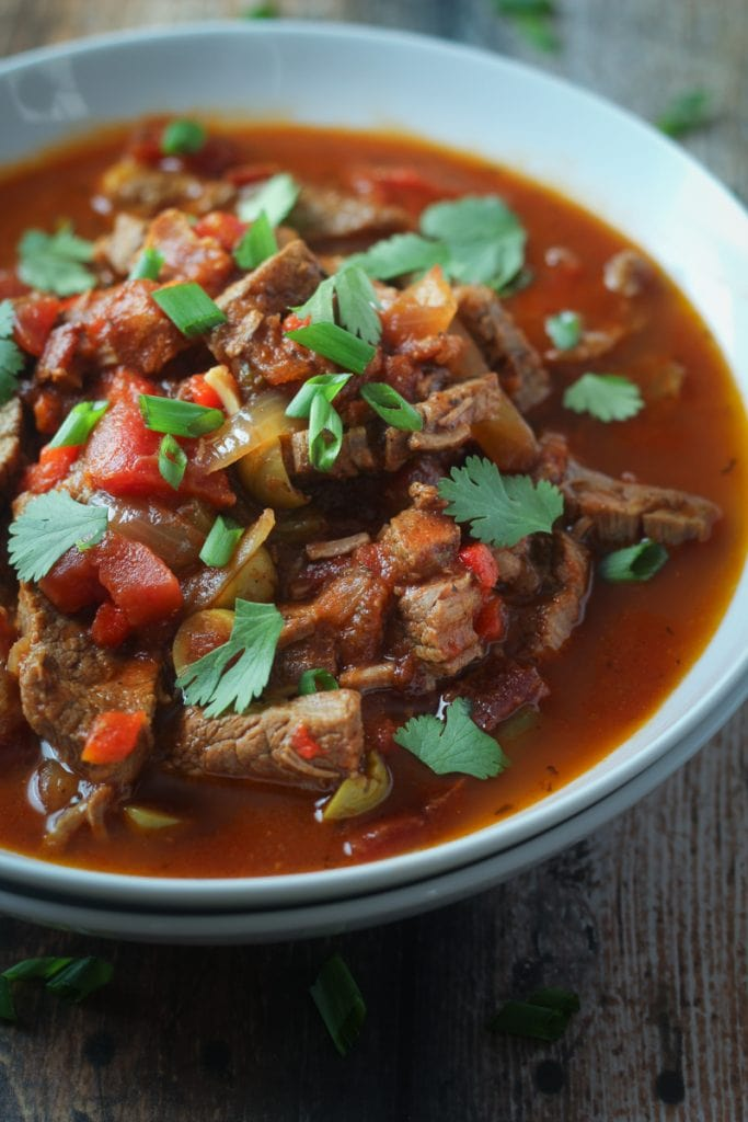 This Cuban Beef Soup recipe makes a hearty beef Cuban soup with bacon, flank steak, red and green bell peppers, onion, tomato paste and spices that you will love!