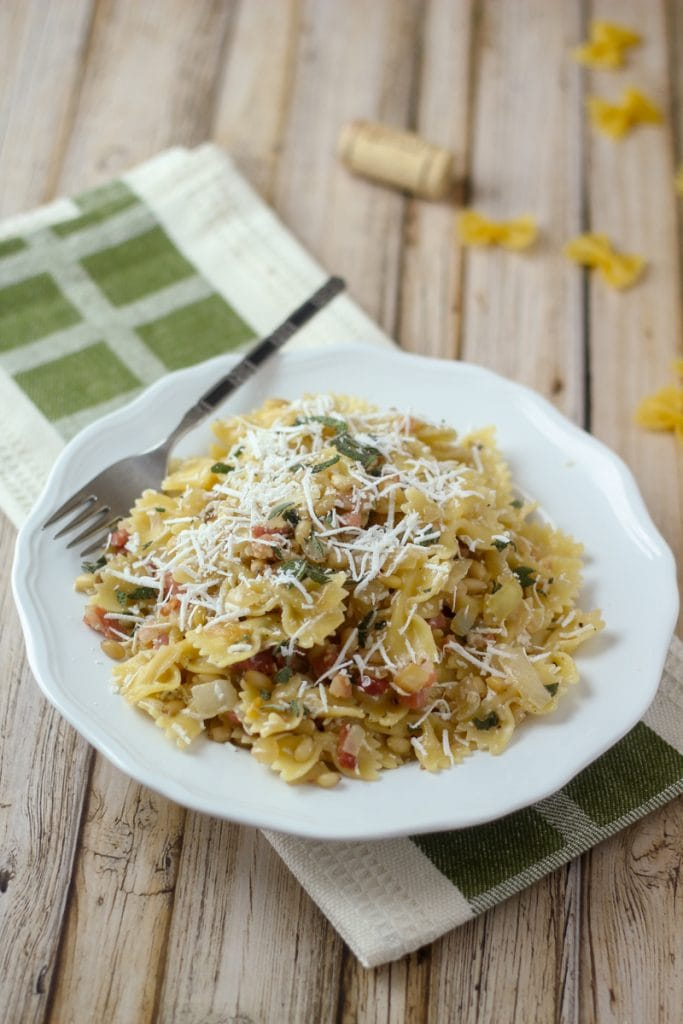 Looking for Farfalle recipes? Here is a great one! This Farfalle Pasta with Pine Nuts recipe blends bow tie pasta, pancetta, pine nuts, sage, onion, garlic and myzithra cheese for a delicious meal in 30 minutes!
