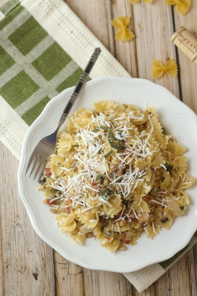 Searching for Farfalle pasta recipes? Try this one! Farfalle with Pancetta, Pine Nuts, and Sage. This Farfalle Pasta with Pine Nuts recipe blends bow tie pasta, pancetta, pine nuts, sage, onion, garlic and myzithra cheese for a delicious meal in 30 minutes!