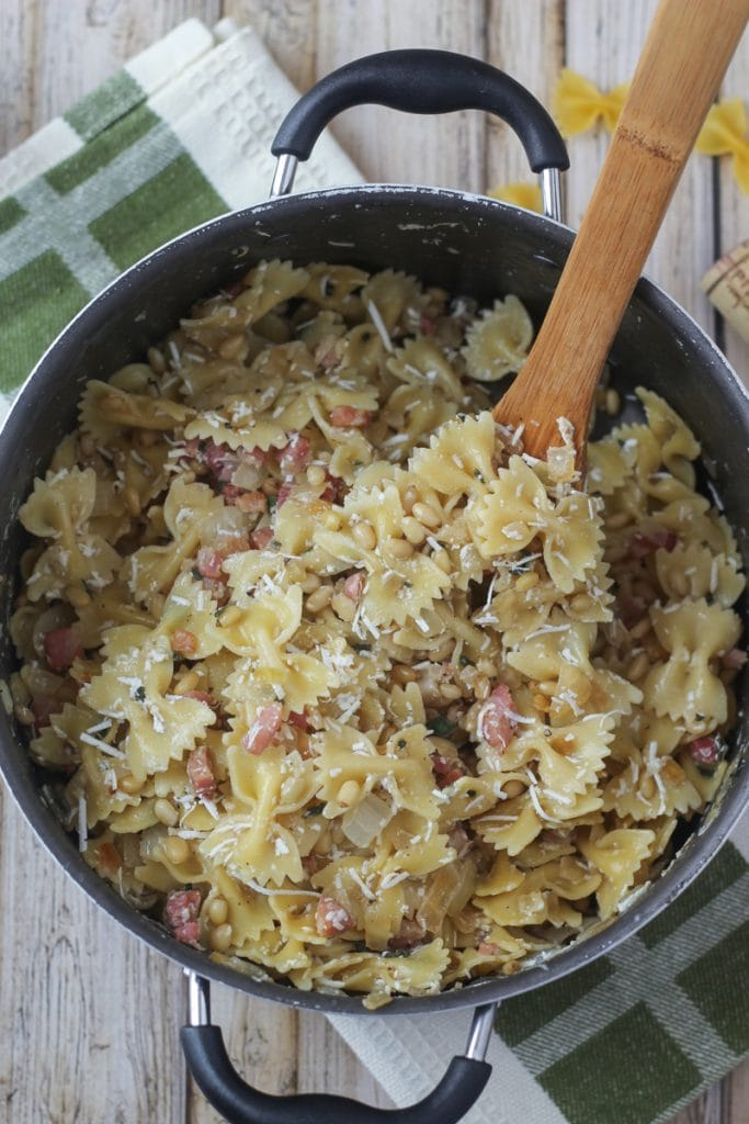 This Pine Nuts Pasta recipe blends bow tie pasta, pancetta, pine nuts, sage, onion, garlic and myzithra cheese for a delicious meal in 30 minutes!