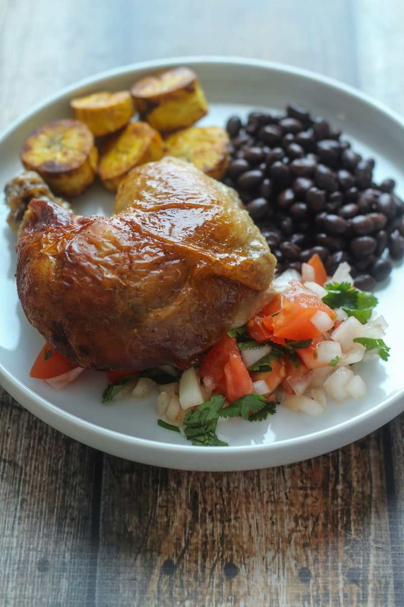 This Roasted Peruvian Chicken recipe is a total cinch to make, and just requires an overnight marinade followed by an hour in the oven.