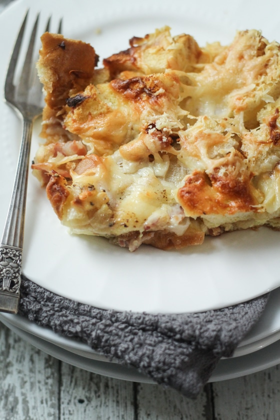 An easy and delicious Italian Strata recipe with pancetta, gruyere, and parmesan cheese. Soak leftover bread in eggs and milk, then bake!