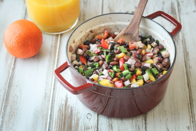 This Mexican Three Bean and Three Pepper Salad recipe is a delicious mix of black, pinto and red beans with yellow and red bell peppers, poblano chili pepper and onion.