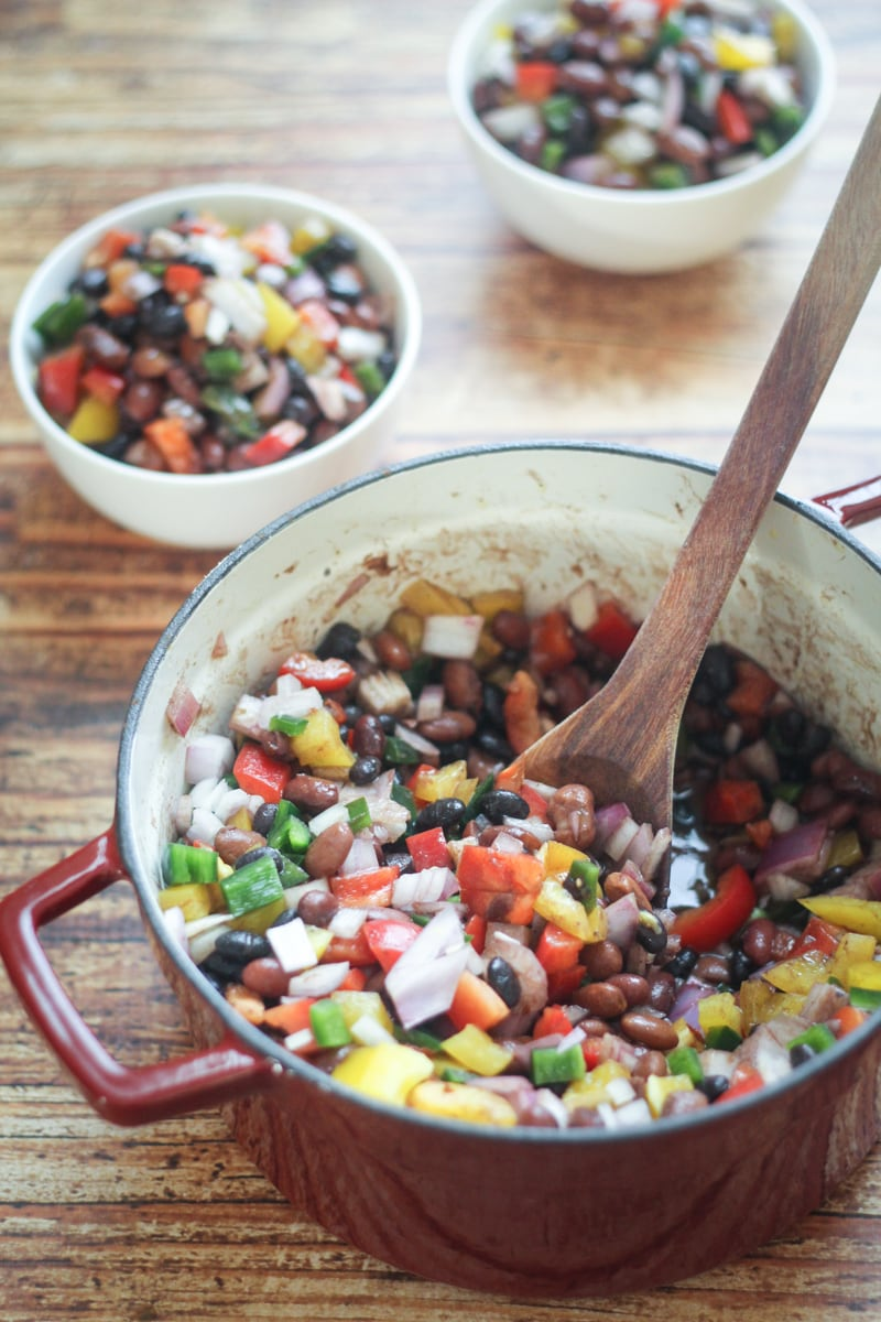 This Three Bean Mexican Salad recipe is a delicious mix of black, pinto and red beans with yellow and red bell peppers, poblano chili pepper and onion.