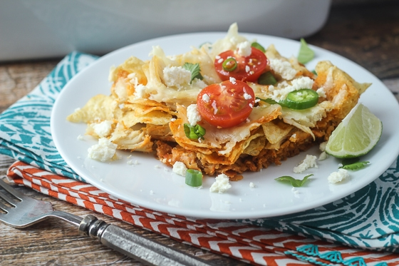 Mexican Chicken Chilaquiles Casserole: This delicious Mexican Chilaquiles Casserole recipe combines chicken, corn tortilla chips, tomatoes, chilies, cheese and spices for an easy meal you will love.