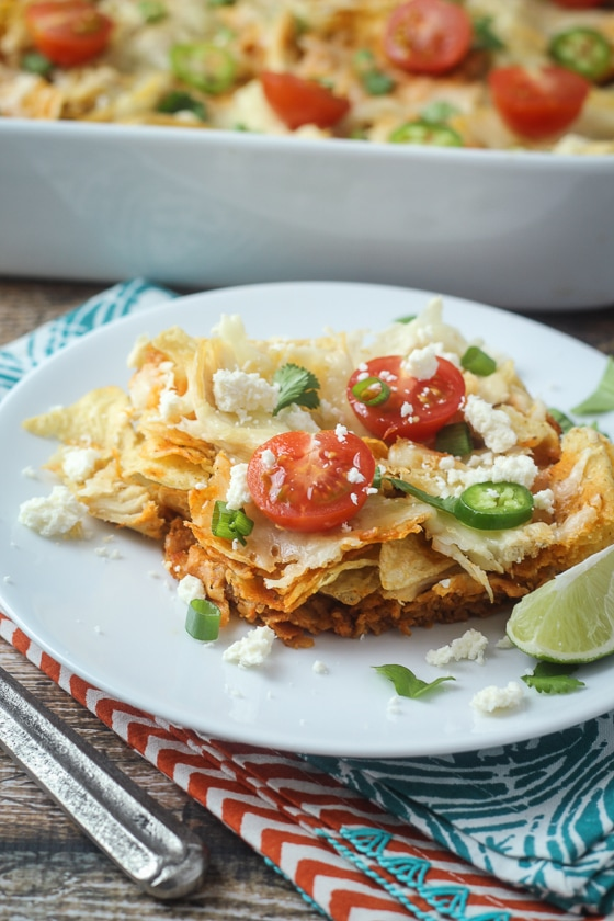 This delicious Mexican Chilaquiles Casserole recipe combines chicken, corn tortilla chips, tomatoes, chilies, cheese and spices for an easy meal you will love.