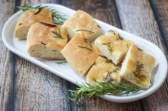 A wonderfully delicious and easy Rosemary and Red Onion Focaccia recipe that will be eaten up fast!