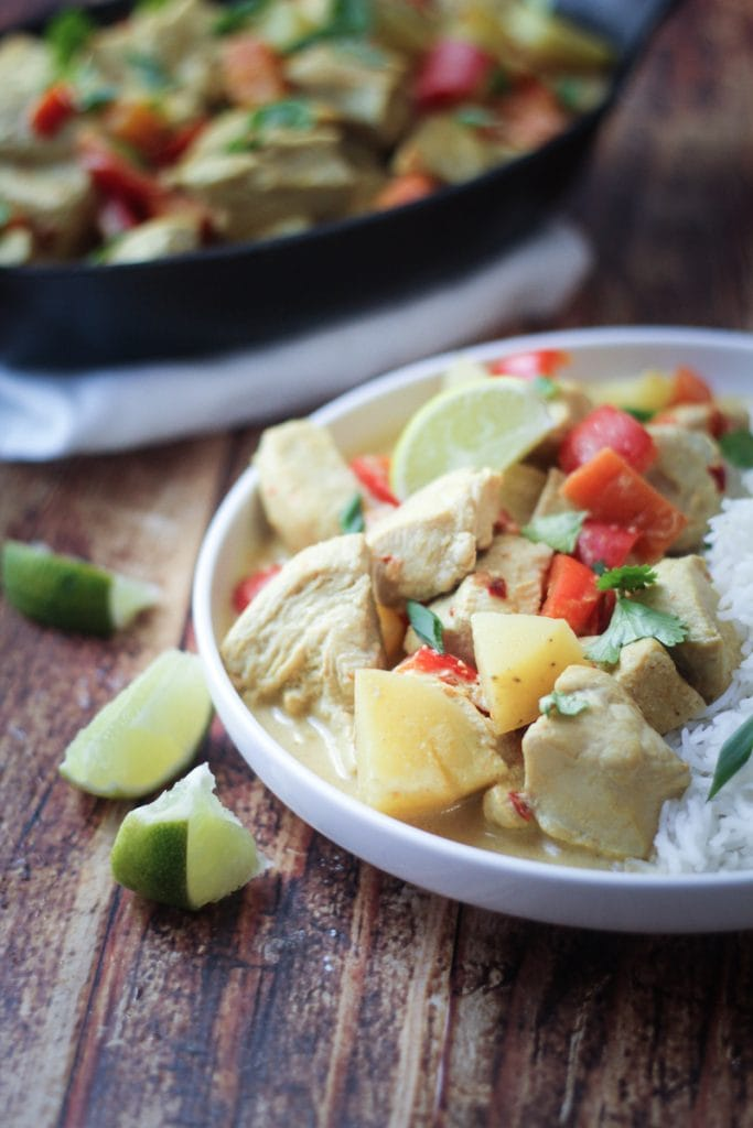 A simple, but delicious Coconut Chicken Curry Crock Pot recipe made with red bell peppers, carrots, potatoes and a coconut curry sauce. Serve over jasmine or basmati rice with fresh cilantro.