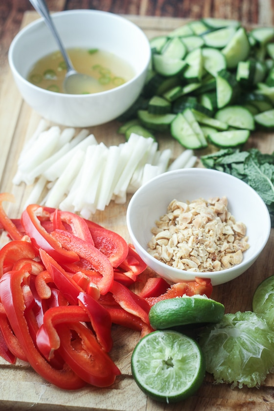 "A delicious and fun recipe for Vietnamese Vermicelli bowls, also known as ""bun,"" with rice noodles, chicken, red pepper, daikon, cucumber, and mint. This bun noodle recipe is delicious!"