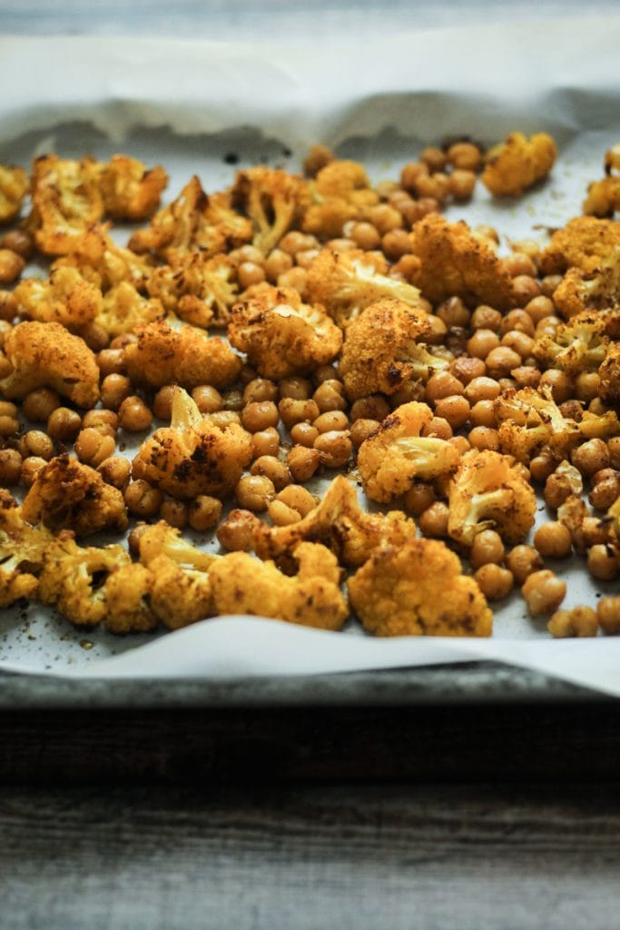 This Vindaloo Roasted Cauliflower and Chickpeas recipe combines cauliflower and chickpeas with a Vindaloo Curry Seasoning. We also added a dressing with mustard seeds, pepper, cayenne, cinnamon and the unique fenugreek. Spicy!
