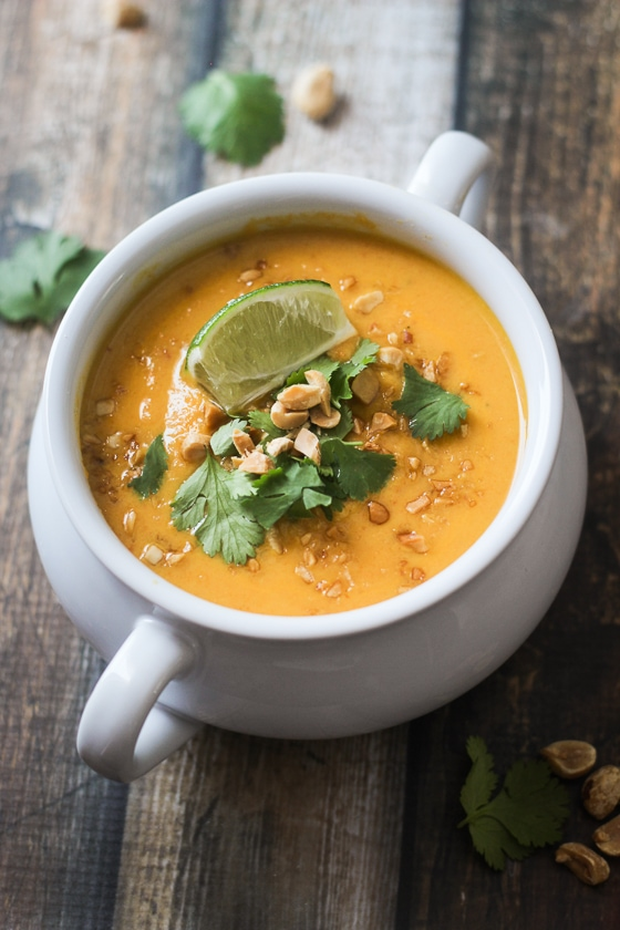 This delicious Thai Carrot Sweet Potato Soup recipe features sweet potatoes, carrots, yellow onion, garlic, coconut milk and spices for a flavorful soup!