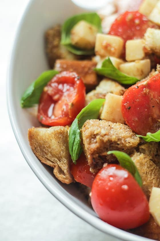 Caprese Panzanella - Tomato, Basil, and Mozzeralla tossed with buttery toasted bread and a balsamic dressing. To die for!