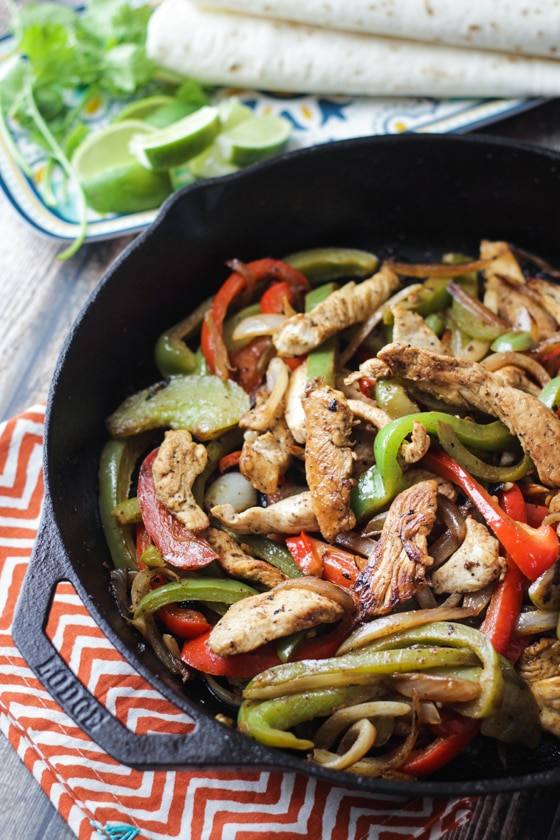 This Tequila Lime Chicken Fajitas recipe is made delicious with an overnight Margarita marinade of tequila, triple sec and lime juice and traditional fajita seasonings and veggies!