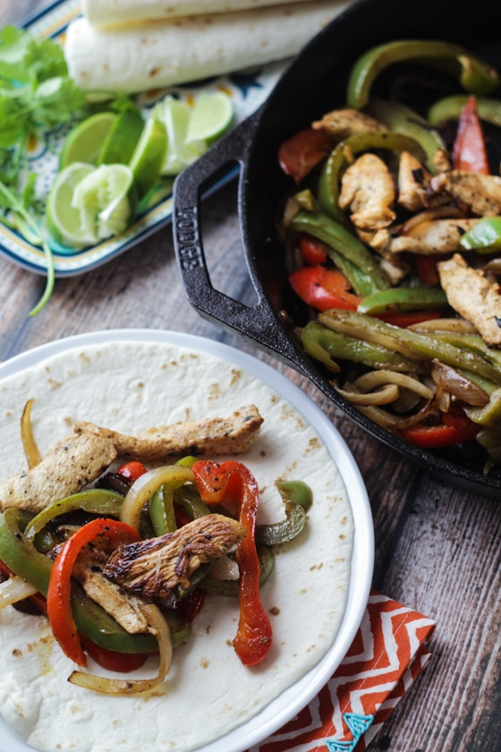 This Margarita Lime Chicken Fajitas recipe is made delicious with an overnight Margarita marinade of tequila, triple sec and lime juice and traditional fajita seasonings and veggies!